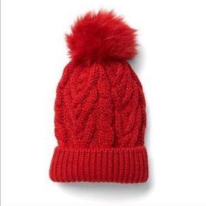 Red knit pom pom beanie